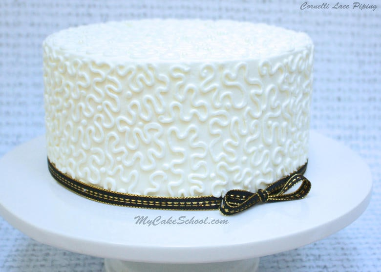 Learn how to pipe beautiful cornelli lace in this My Cake School cake decorating video!