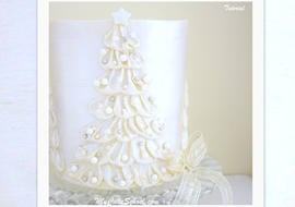 Learn to make a gorgeous White Chocolate Ganache Christmas Tree Cake! A cake decorating video tutorial by MyCakeSchool.com!