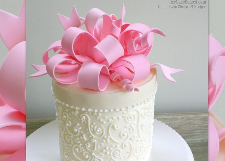 Learn to make BEAUTIFUL gum paste loopy bows in this My Cake School cake decorating video tutorial!