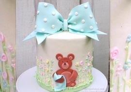 How to make an adorable classic gum paste bow and teddy bear themed cake in this My Cake School video tutorial!