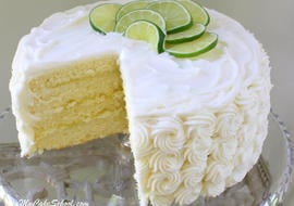 This Delicious Homemade Lime Cake Recipe is filled with lemon curd & frosted with cream cheese frosting. Recipe by MyCakeSchool.com!