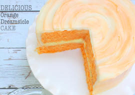 This scratch Orange Dreamsicle Cake is heavenly!! Super moist and delicious. Recipe by MyCakeSchool.com.
