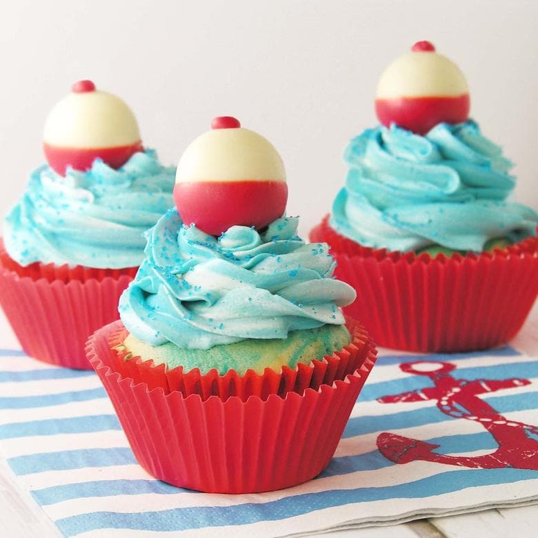 CUTE Fishing Bobber Cupcake Tutorial by EasyBaked.net as featured on MyCakeSchool.com's Father's Day Cake Roundup!