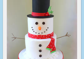 Sweet Snowman Cake! A cake decorating video tutorial by MyCakeSchool.com.