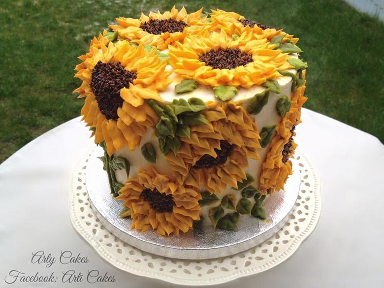 Beautiful Buttercream Sunflower Cake by Arti Cakes, as featured on MyCakeSchool.com's Roundup of Favorite Fall Cakes and Ideas!