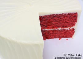 The BEST doctored cake mix Red Velvet Cake recipe! Super moist, delicious, and fantastic with Cream Cheese Frosting! MyCakeSchool.com.
