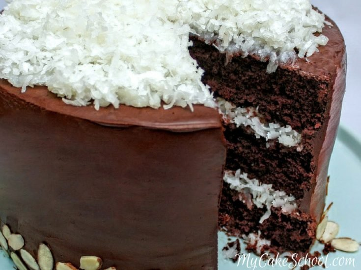 Decadent Almond Joy Cake Recipe by My Cake School! Rich chocolate cake layers with coconut filling, ganache, and almonds! My Cake School.