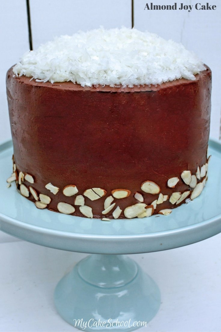Heavenly Almond Joy Cake Recipe! Decadent Chocolate Cake Layers with Coconut Filling, Ganache, and almonds. MyCakeSchool.com.
