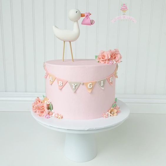 CUTE and simple Stork Baby Shower Cake by Little Hunny's Cakery as featured on My Cake School's roundup of Baby Shower Cake Ideas!