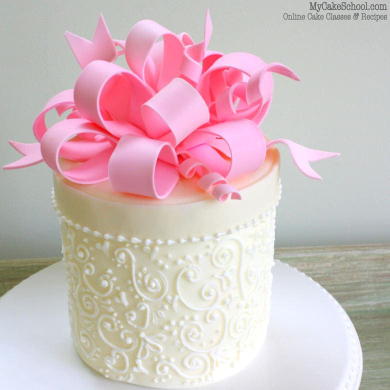 Learn to make a beautiful loopy gum paste bow in this cake decorating video tutorial by MyCakeSchool.com! (member cake video section)