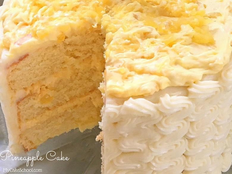 AMAZING Pineapple Cake! Moist yellow cake layers with pineapple and cream filling and cream cheese frosting! Recipe by MyCakeSchool.com!