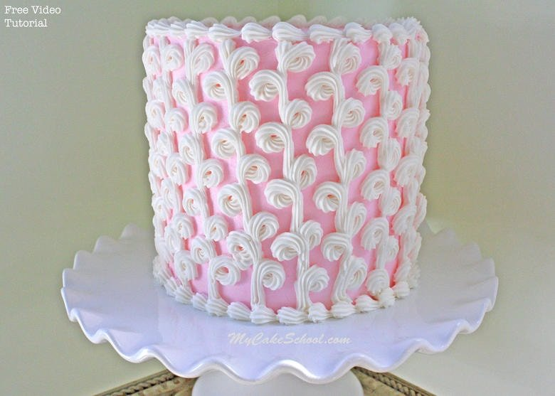 This elegant cake design features loops of buttercream piping! Learn the simple, impressive method in MyCakeSchool.com's free cake video tutorial!