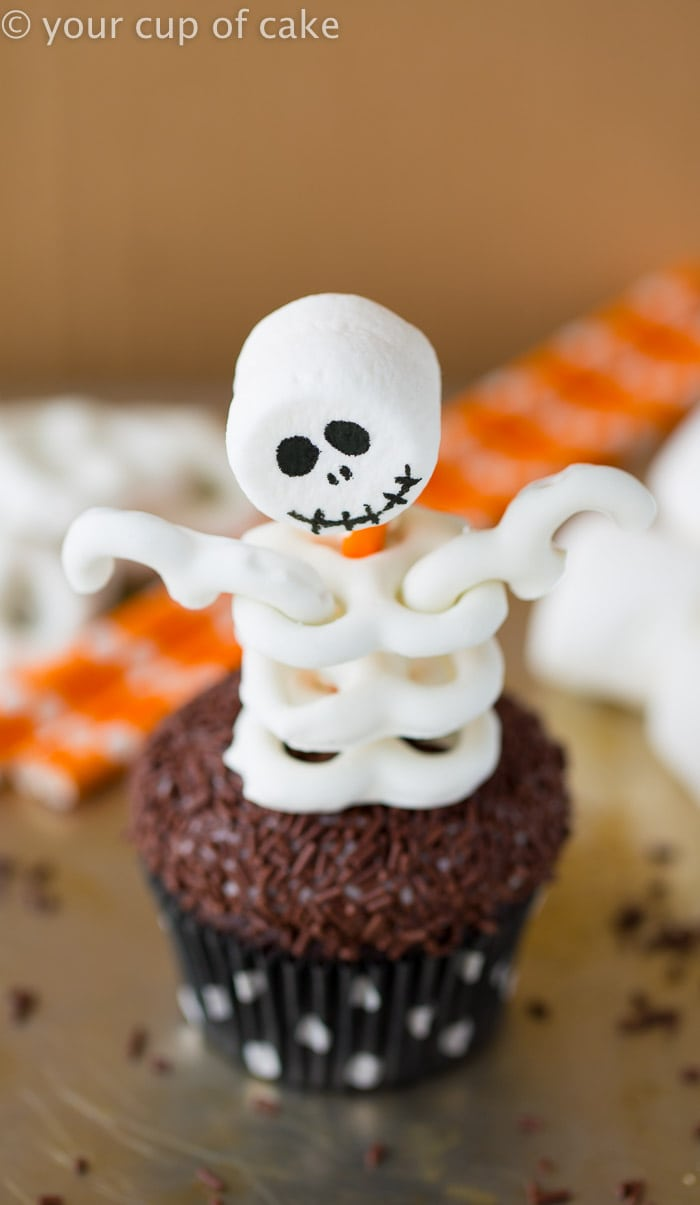 Spooky Skeleton Cupcakes by One Little Project (as featured on MyCakeSchool.com's Roundup of Halloween Cake Ideas!)