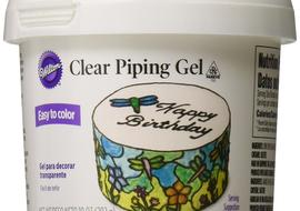 Wilton Clear Piping Gel. We use this often as an edible adhesive in cake decorating and modeling.