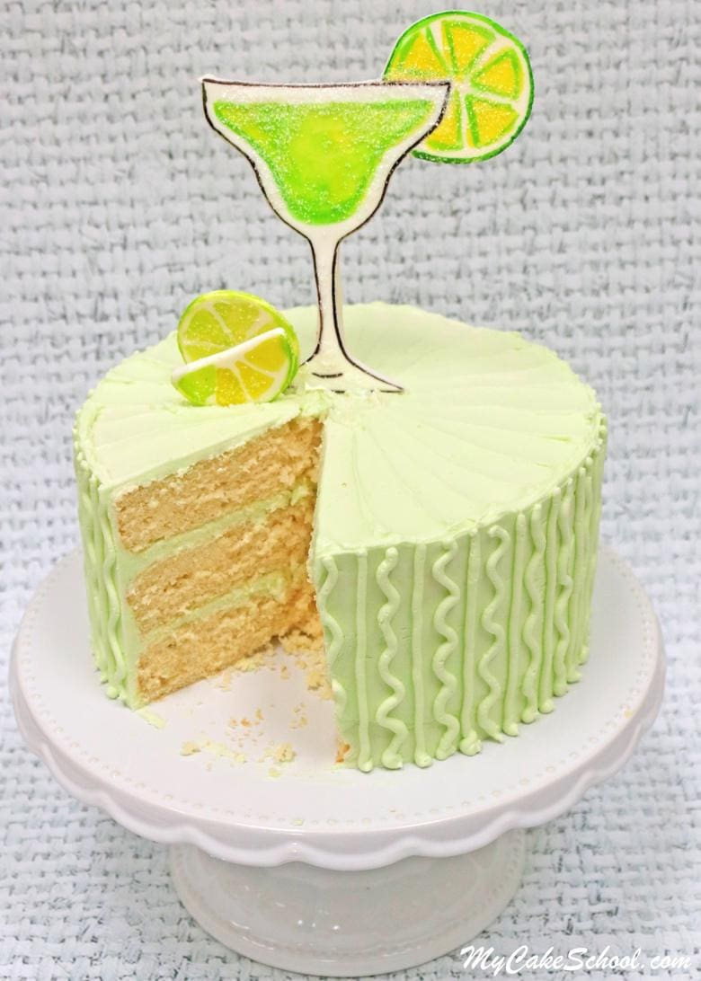 Moist and Delicious Margarita Cake- A Doctored Cake Mix recipe! You'll LOVE this flavorful lemon and lime cake frosted in Tequila Lime Buttercream! Perfect for Cinco de Mayo and summertime entertaining!