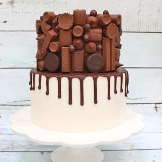 Candy Bar Drip Cake Tutorial by MyCakeSchool.com