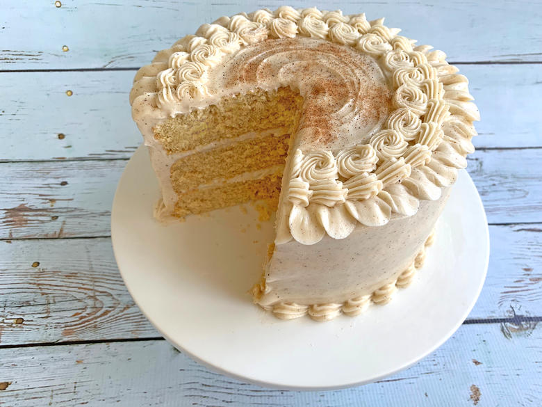 The BEST Eggnog Cake with Eggnog Cream Cheese Frosting- This is a doctored cake mix recipe.