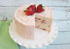 This Champagne and Strawberries Cake by MyCakeSchool.com is SO moist and delicious- it is the perfect special occasion cake!