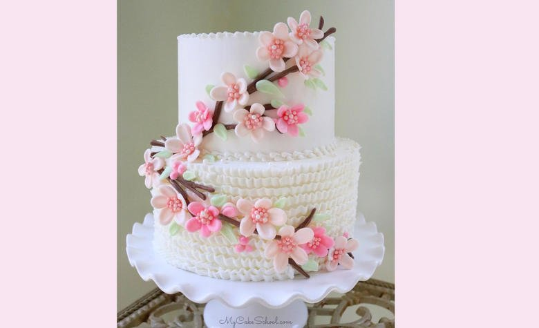 This cherry blossom cake is the perfect cake for spring! We've made simple, elegant cherry blossoms with chocolate candy coating.