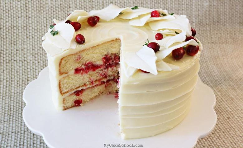 White Chocolate Cranberry Layer Cake- This recipe has the perfect balance of tartness from cranberries and sweetness from white chocolate! This flavorful cake is perfect for holiday entertaining!