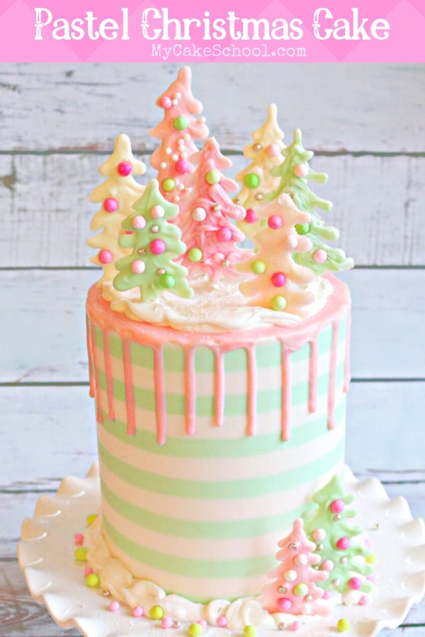 This pastel Christmas Cake was so much fun to make! We love the striped buttercream, pink drip, and colorful chocolate trees!