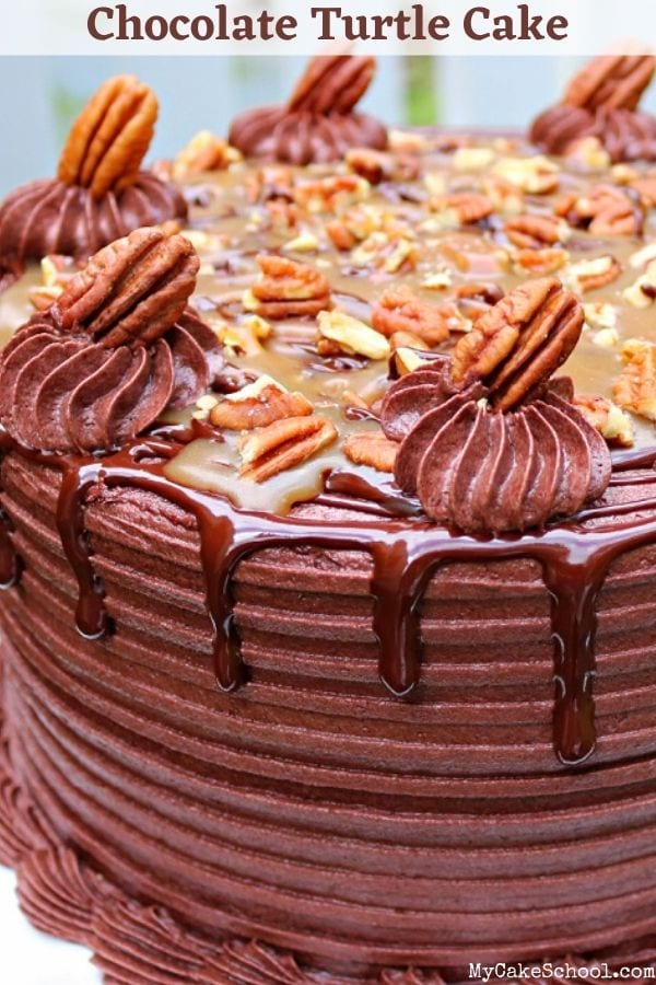Decadent Chocolate Turtle Cake Recipe- This layer cake has an amazing combination of homemade caramel sauce, toasted pecans, decadent chocolate cake, ganache, and chocolate buttercream!
