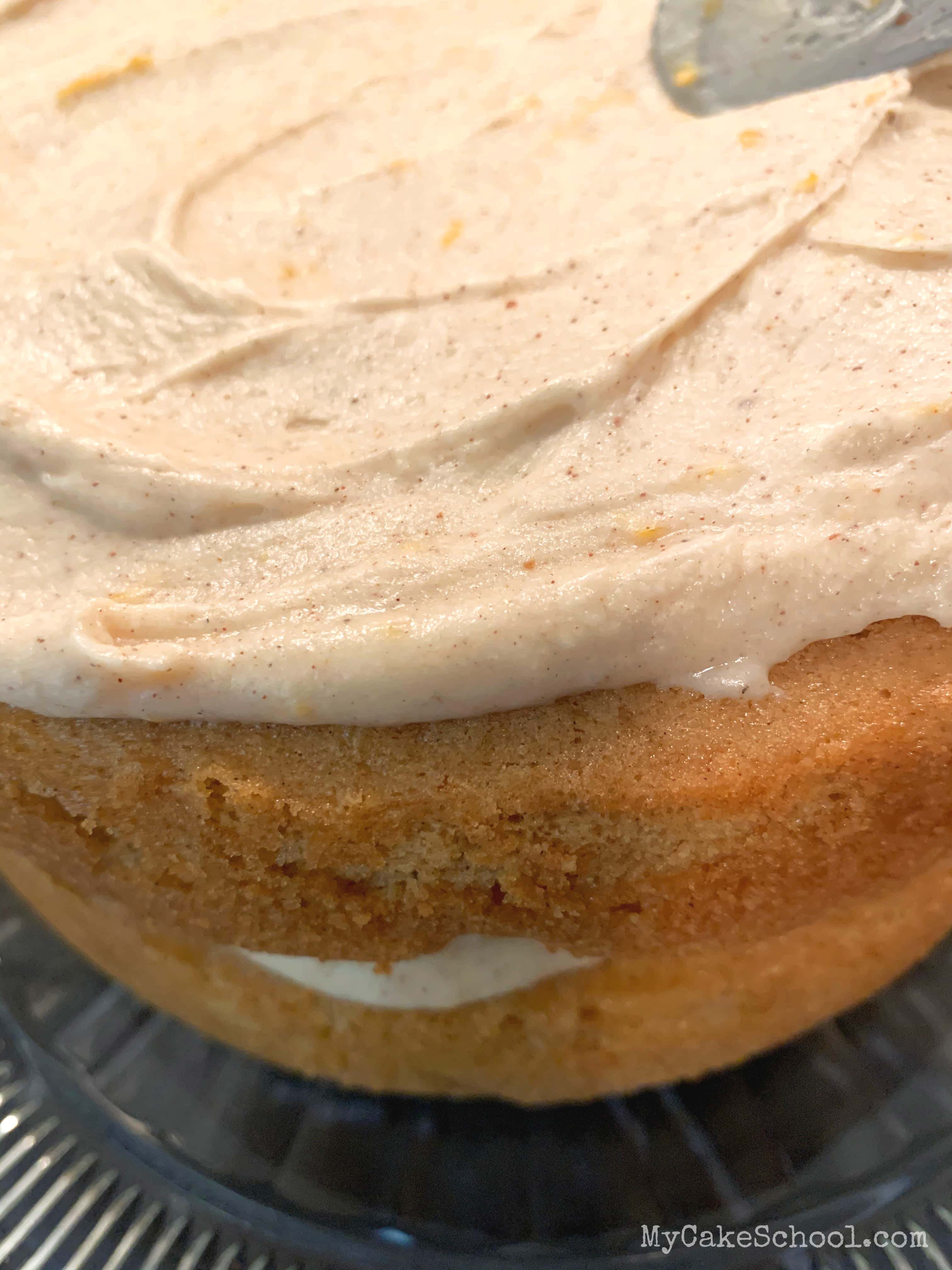 This Orange Spice Cake all starts with a doctored cake mix! This is the perfect fall dessert!
