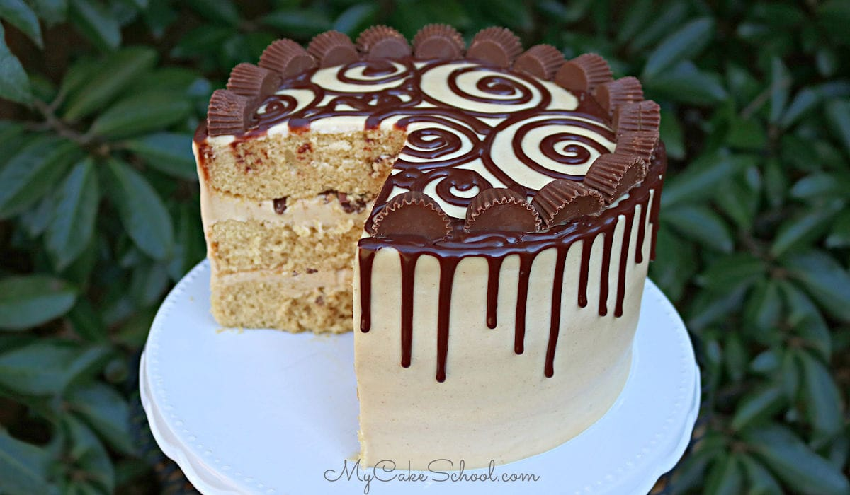 This moist Peanut Butter Cake starts with a cake mix! It is so delicious with peanut butter cream cheese frosting and a decadent ganache drip!