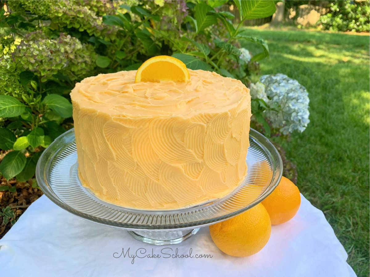 Orange Dreamsicle Cake- A Doctored Cake Mix Recipe- SO moist and delicious!